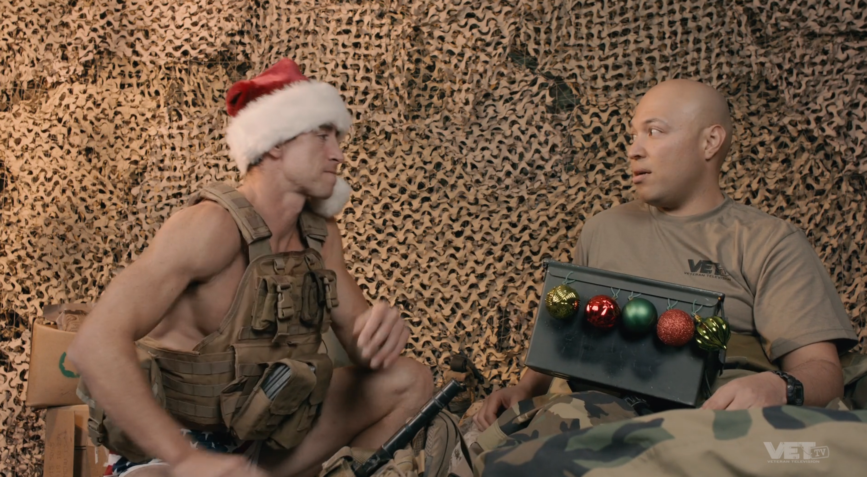 Donny OMalley sits with a soldier during Christmas.